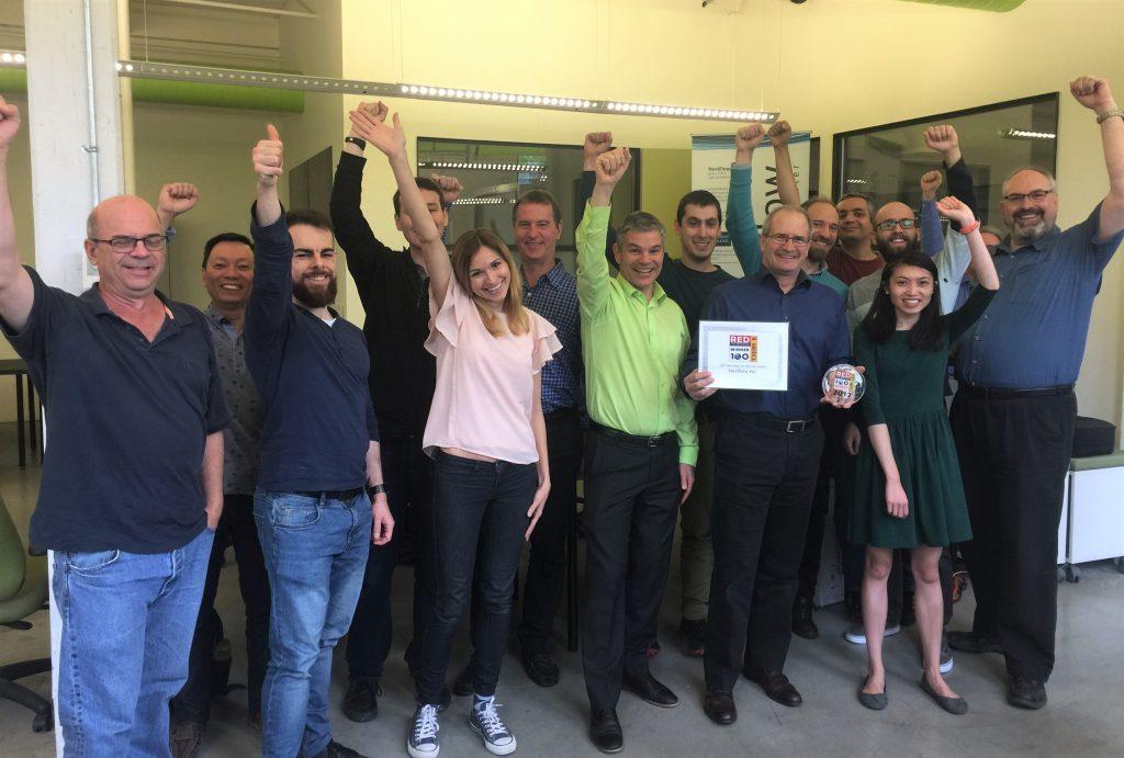NoviFlow Team celebrating Red Herrinf Top 100 Award